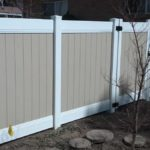 2-tone vinyl privacy fence with 8-inch rails