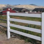 White vinyl 4 rail ranch rail fence in Herriman, Utah