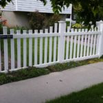 White vinyl scalloped picket fence with flat picket caps in American Fork, Utah